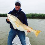 Angler with a very large redfish