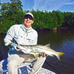 happy angler with snook